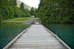 Wood Boat Dock. On Lake Crescent, Washington State, USA. Dark Green Super Clean Lake Water. Olympic National Park Royalty Free Stock Photos