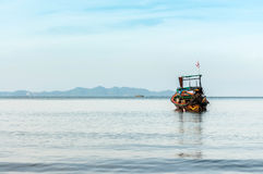 Wood boat float in the sea Royalty Free Stock Photo