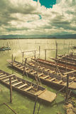 Wood boat in lonely lake vintage tone Stock Photography