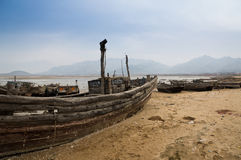 Wood boat on the sand beach. With cloudy sky Royalty Free Stock Image
