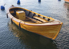 Wood boat. Varnished old wood boat at the quay Royalty Free Stock Photography