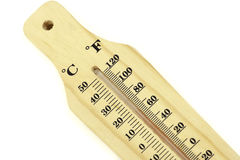 A wood bodied thermometer. A close up to a simple wood bodied thermometer isolated on white Royalty Free Stock Images