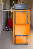 Firewood boiler. In the boiler room stock photos