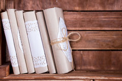 Wood book shelf with vintage books heap. Wood book shelf with old books heap and candle in rustic style stock photo