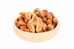 Wood bowl full of nuts Royalty Free Stock Photos