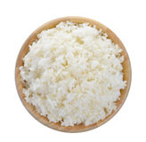 Wood bowl full of rice on white background Royalty Free Stock Photography