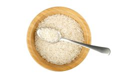 Wood bowl with rice and steel spoon Stock Photography