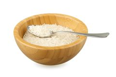 Wood bowl with rice and steel spoon Royalty Free Stock Photography