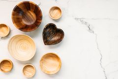 Wood bowl. On white marble stone background Stock Photos