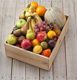 Wood Box Of Fruit. Mixed fresh fruit in a wood crate and wood background Stock Photo