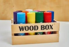 Wood box full of big crayons royalty free stock photography