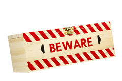 Wood Box with Red Chevron Worded Beware Royalty Free Stock Photography
