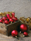 Wood box with red Christmas decorations. New Year and Xmas card background. Copy space. Selective focus. Royalty Free Stock Photo
