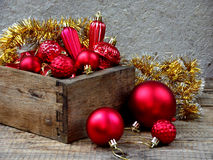 Wood box with red Christmas decorations. New Year and Xmas card background. Copy space. Selective focus. Stock Image