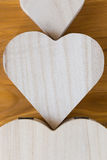 Wood box shaped heart on brown background Stock Image