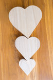 Wood box shaped heart on brown background Royalty Free Stock Photo