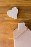Wood box shaped heart on brown background Royalty Free Stock Photography
