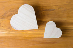 Wood box shaped heart on brown background Royalty Free Stock Images