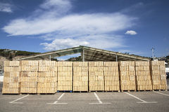 A Shed in a commercial dock. Wood boxes apiled in a shed of a commercial dock Royalty Free Stock Photos