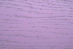 Wood bräde med den purpurfärgade beläggningen arkivfoto