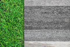 Wood bräde på grönt gräs royaltyfri bild