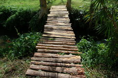 Wood Bridge. A bridge made of wood and supported by two bamboo poles Stock Image