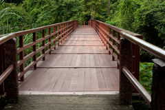 Wood bridge across river . Stock Images