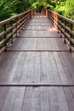 Wood bridge across river . Royalty Free Stock Image
