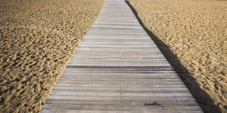 Wood bridge on beach Stock Image