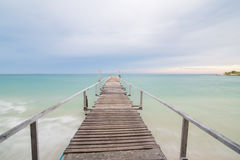 Wood Bridge on the beach Stock Images