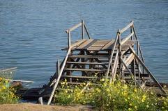 Wood bridge near river Royalty Free Stock Images