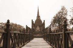 Wood bridge. On old pagoda background Royalty Free Stock Images