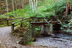 Wood bridge over creek Stock Image
