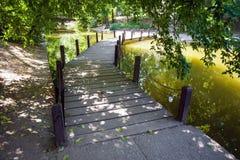Wood bridge over the defense lake surrounding Vajdahunyad Castle Stock Photo
