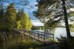 Wood Bridge Over Lake In Sweden At Autumn Stock Image