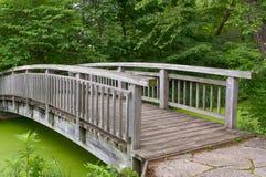 Wood Bridge Over Pond Stock Photo