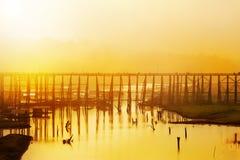 Wood bridge over river Stock Photo