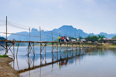 Wood bridge over river song, Vang vieng, Laos Royalty Free Stock Photos