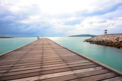 Wood bridge over the sea Stock Photo