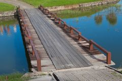 Wood Bridge Over the Water in Golf Course. With Reflex of Golfer, Thailand Royalty Free Stock Photography