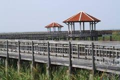 Wood bridge and pavilion Stock Images