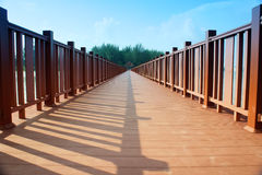 Wood bridge perspective. Center view Stock Photos