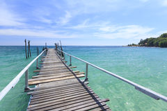 Wood bridge pier on summer tropical sea in blue sky. Royalty Free Stock Photography