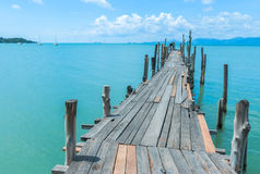 Wood bridge and the sea. Pier, boardwalk, wood, thailand, footpath, water, day, horizontal, tranquil scene, architecture, famous place, mountain, rural scene Royalty Free Stock Photos