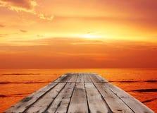 Wood bridge on sea twilight Stock Photo