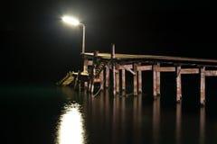 Wood bridge with seascape at twilight time. Stock Image