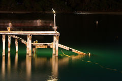 Wood bridge with seascape at twilight time. Stock Images