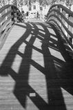 Wood bridge. Shadows described by a small wooden bridge Stock Images