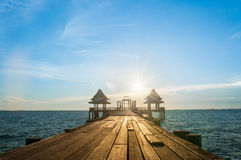 Wood Bridge Silhouette. A Wood Bridge in sea. shoot while sunset Stock Photography
