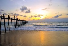 Wood bridge with sunset beach Stock Photos